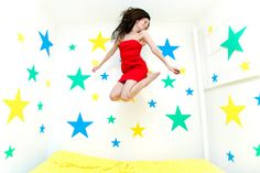 color me katie jumping on the bed: Katie says: Last night I cut out a bunch of stars, to cover my walls, so that jumping on the bed feels like jumping through outer space!
