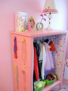 As soon as I can get Gibby a new dresser, his old one will be converted to a dress-up closet like this.  Maybe a little more co-ed than girly, so Gib's fireman coat and other boy stuff won't be forced into a girly fru fru closet!