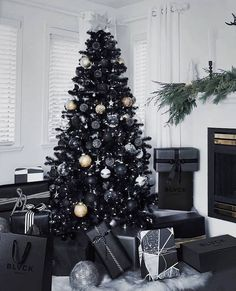 black christmas tree Comment if we should drop the Blvck christmas giveaway tomorrow. Black Christmas Trees, Noel Christmas, Primitive Christmas, Halloween Christmas Tree, Black Christmas Tree Decorations, Elegant Christmas Trees, Silver Decorations, Halloween Decorations, Diy Natal
