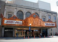 The Stanley Theater A glittering copper marquee spans the entrance, overhanging the solid brass doors. Over the marquee are three large arched windows. Building materials include marble from Italy, Vermont and Texas, limestone from Indiana, and granite from Maine to face the Corinthian columns.