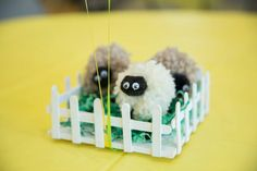 Sheep theme baby shower centerpieces.