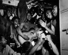 US Navy African-American enlisted sailors aboard USS Ticonderoga celebrating upon hearing the news of Japanese surrender, 14 Aug 1945 / Barrett Gallagher