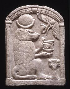 Egyptian limestone relief depicting the god Thoth in baboon form holding a wedjat-eye (eye of Horus, symbol of well-being) and neb-basket (symbol of divinity). British Museum