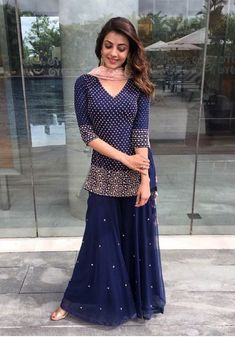 South Indian actress Kajal Aggarwal dons a royal blue sharara with embellishments all over the top. Such an elegant look for the festival season! Indian Wedding Outfits, Pakistani Outfits, Bridal Outfits, Indian Outfits, Indian Dresses, Indian Clothes, Indian Attire, Indian Wear, Anarkali