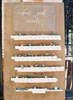 Rustic wooden wedding escort card display: http://www.stylemepretty.com/little-black-book-blog/2017/02/16/romantic-baltimore-wedding-turkish-rug/ Photography: Michael and Carina - http://www.michaelandcarina.com/