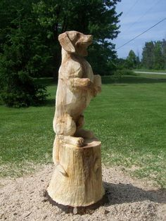 Begging dog - Carvings by Scott, a Michigan Chainsaw Carver