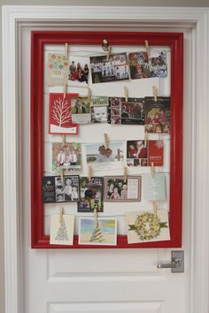 DIY: thrift store frame made into a Christmas card display using picture frame wire and clothespins.
