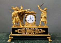 [Click on image to enlarge] A Late 19th Century Empire Style Gilt Bronze Mantel Clock