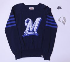 "Get this look at the #Brewers Team Store:  Women's ""M"" Sweater- $99.00 Heart Charm Necklace- $40.00 Teardrop Earrings- $60.00"