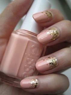 For the perfect mani to wear to all those summer weddings, pick a peachy polish and add a swipe of gold sparkles along the bottom half of your nails. See more at Beauty Riot »