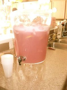 2 gallons raspberry sherbert, 2-3 liters 7up, and add some sliced lemon... good for punch at the reception or bridal shower