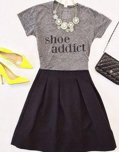 Statement necklace. Tshirt. Skirt & heels. Out shopping attire.