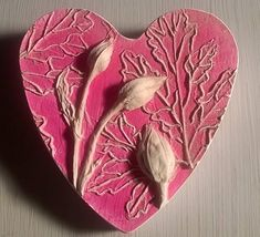 Buds on Pink Heart. Unique fusion of mono cast & mono print plant impression cast in plaster. I love experimenting with new techniques and was so pleased to find a way to incorporate colour into my work. This heart comes ready to hang. This unframed heart tile is a plaster cast of
