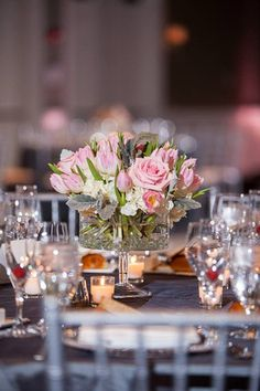 Spring Wedding Blush Pink, White, Ivory, and Charcoal Grey.  Pedestal Low Centerpiece with Hydrangea, Roses, Dusty Miller, and Tulips.  Hotel Arista Wedding Reception. Jasmine Galleria Chicagoland Floral and Decor