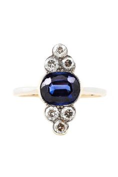 From the unique shape to the striking blue sapphire, this is the kind of vintage piece you dream about.