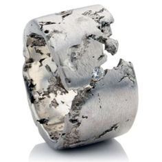 The piece is inspired by natural textures and takes on the appearance of pitted rock.