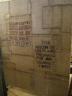 layering pieces of coffee sacks with wall paper paste and tacs