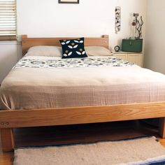 This is a FULL tutorial and plans for a queen size slatted bed frame with headboard. It's a sturdy design with modern industrial details.