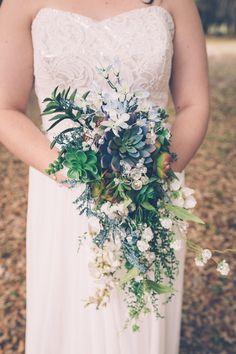 Cascading succulent bouquet in shades of blue, white and green - stunning and unique! {Darin Crofton Photography}