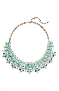The combination of mixed-color jewels on this statement bib necklace will light up any outfit!