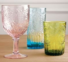 Love the soft pastels.  Distinguished Glass Company can paint glasses ANY COLOR you choose!