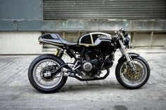 RocketGarage Ducati Cafe Racer : Reminds me of the racer from Tron Legacy!