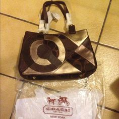 Authentic Coach Multi- Chocolate Patchwork Tote Authentic Coach Multi chocolate Tote bag really spacious. Three different compartments inside purse. If you buy two or more bags, I will do a discount. No Trade! Firm on price but the least I would sell this purse is for $300. Accept PayPal. Any questions feel free to ask. Coach Bags Totes