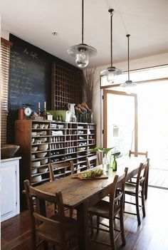 Open shelving, rustic table and chairs, industrial fixtures, loads of natural light.