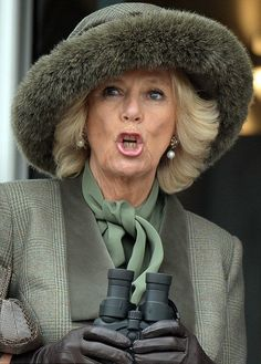 A tense Camilla, Duchess of Cornwall roars on the runners as she watches the Novices Hurdle on 11.03.2015
