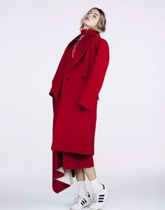 Oversized red coat with casual Adidas sneakers. // Photo by Naomi Yang