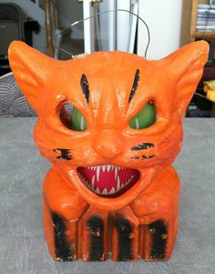 Vintage Halloween Paper Mache Orange Cat on Fence. From eBay seller grannyszoo.