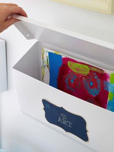 Love this idea. Use a mailbox mounted on teh wall to hold art supplies and small pictures. Hide the clutter.