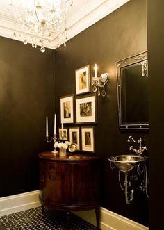 A glamorous little bathroom. Look at that sink!