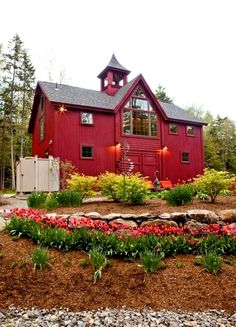Beautiful spring color at this post and beam barn home!