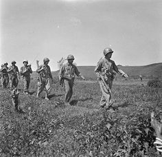A 6-2 Section of the First Special Service Force Staff-Sergeant K.S. Chapman, carrying a Thompson submachine gun; Sergeant T.C. Potenza, carrying a Johnson light machine gun; Sergeant N.J. Overall, carrying a Bazooka; Sergeant T.F. Olynyk, carrying an SCR-536 radio; Sergeant H.W. McCarthy, carrying a Thompson submachine gun (R-L) during a battle drill at Anzio beachhead, Italy, in late April, 1944. REUTERS/Lieut. C.E. Nye/Canada Department of Defence Archives