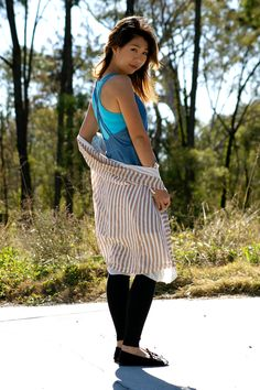 Jessie Denim play dress worn with a blue tank, black tights and a striped chiffon top.