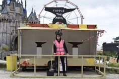 """""""Dismaland,"""" a satirical take on a theme park created by the artist Banksy, features grumpy guards, funereal theme park games and works by about 60 artists."""