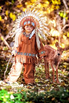 Halloween costume Indian boy in the woods with a baby deer. www.raisinghavik.com