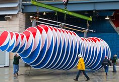 Designed by Pentagram's Michael Gericke and his team, the huge installation transforms the gate into an unexpected celebration of the Pepsi brand.