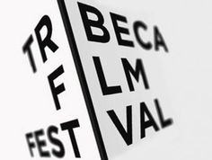 "New York, city streets, skyscrapers, street signs, moving film through a projector... And then there's the ""I"" that takes it to the next level. Tribeca Film Festival logo"