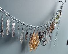I use this for my dangling earrings - simple chain and tea cup hooks.