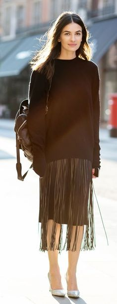 Keep it interesting with fringe. black sweater with fringe midi skirt