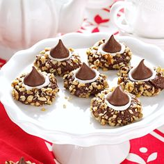 """Chocolate Thumbprints Cookies Recipe -My group of friends had a weekly """"movie night"""" during winters on Martha's Vineyard, and we'd take turns making a chocolate treat to share. These terrific cookies were an instant success. Once they debuted, I had to make them many more times. —Laura Bryant German, W. Warren, Massachusetts"""
