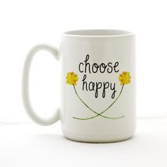 "Ceramic coffee mug with yellow flowers and a daily reminder to ""choose happy"". Larger 15oz size. Dishwasher and microwave safe. We design every mug in house and create each one by hand in our Richmond, Va. studio using professional supplies and equipment to ensure quality. Ships protected in a sturdy white gift box."
