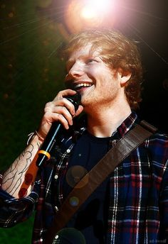 Ed sheeran. I love how you see his mother and child tattoo. So cute