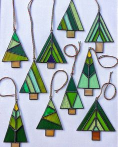A forest of new stained glass Christmas tree designs made and now available in my Etsy shop. 🌲🌲🌲🌲🌲 (I know it's still October but there are… Stained Glass Ornaments, Stained Glass Christmas, Stained Glass Crafts, Stained Glass Designs, Glass Christmas Tree, Fused Glass Art, Stained Glass Patterns, Mosaic Glass, How To Do Stained Glass Diy