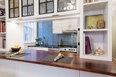 A teeny half-galley Brooklyn Heights kitchen opens up with the removal of a wall and doubles up in storage space with custom cabinets. Narrow Kitchen, Old Kitchen, Kitchen Reno, Small Wine Racks, Paris Kitchen, Gold Interior, Black Floor, Marble Countertops, Custom Cabinets