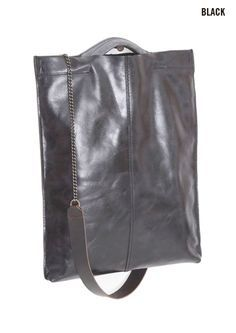Jo Handbags, an uncommon blend of natural burlap, industrial fabrics, and boot leather.