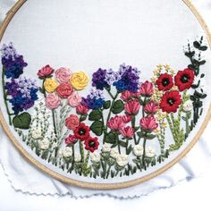 """Do you love stitching flowers? If so, this Bloom Embroidery Kit is for you!! I have included a step-by-step guide (with pictures) to every single flower in this pattern. By the time you are through, you'll be a pro and feel extremely confident with your next embroidery project. Your kit will include: - Pre-printed BLOOM pattern on high-quality cotton - 8"""" embroidery hoop - All 22 colors of coordinating DMC embroidery floss (optional) - Embroidery scissors (optional) - Detailed s..."""