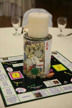 Gameboard Centerpiece- We had 20 tables, each had a different boardgame.  I used large playing cards as table numbers and put all the pieces from each game inside the glass cylinder.